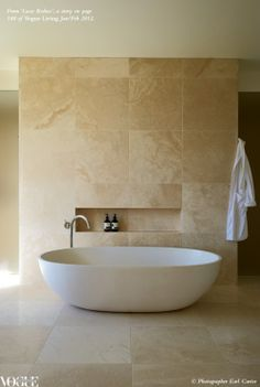Large format beige marble or travertine look on walls and floor