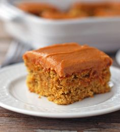 This banana cake with peanut butter frosting just happens to be vegan! Perfectly sweet and moist cake with a decadent peanut butter frosting. Yum! | pinchofyum.com