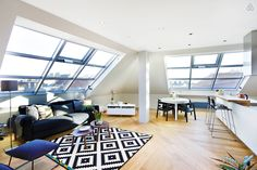 The living room, dinning area and kitchen are bright and spacious.