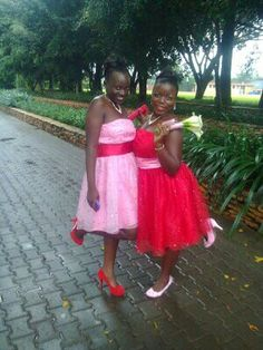 Mixture of red and pink dresses that would make the maids colourful for a wedding