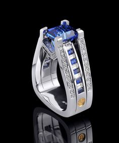 September Birthstone - Sapphire.  From the Interlace collection, this stunning platinum ring centers a 6.63 carat emerald cut Sapphire accented by baguette cut Diamonds and Sapphires and round brilliant cut Diamonds #coffinandtrout #jewelry #sapphire