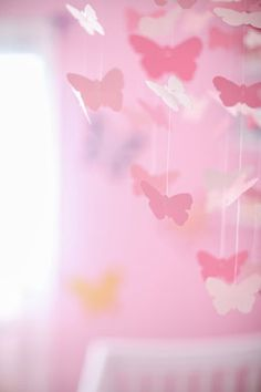 pink butterfly themed party...hanging  mobile deco. would be cute to hang over tables & over the cake table .you could use more than one...cute idea