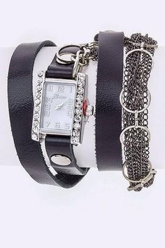 Edgy and sweet faux leather wrap watch. Features rhinestone rimmed face and chain accents. Stainless steel back. Measures 23 inches from end to end.