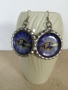 Check out Baltimore Ravens accessories in our Etsy shop https://www.etsy.com/listing/244598470/baltimore-ravens-earrings-hand-made