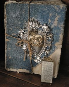Original pinner sez: Antique french book w/Ex Voto    how cool would it be if this was your diary???