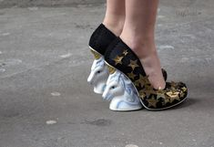 The heels of this shoe are made out of Unicorns and Cats!