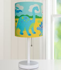 Olive Kids Dinosaur Land Cylinder Lamp - 631412 $50 Brighten up your child's room with an Olive Kids lamp! Our wooden based, steel stemmed lamps are topped with a printed fabric lamp shade. Each lamp coordinates wonderfully with our bedding and other room d