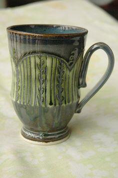 Handmade porcelain mug inlaid with black copper wash.