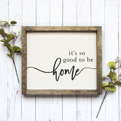 This Its So Good To Be Home sign adds the perfect farmhouse touch to your home! It measures approximately 13.5 inches wide x 11.5 inches tall. The sign is hand-painted and framed. The lettering is black script and the background is off-white. The frame is solid wood and stained in jacobean. Like