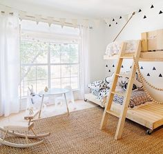 Love this shared kids room!!!! White walls | natural wooden bunk beds | black wall decals