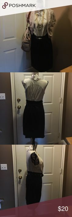 Cream and black midi dress This is one of my favorite pieces. Sleek fitting only worn once. Slimming belt at mid section. I am 5'9 and this dress hangs on me to about mid thigh.  Can be worn in a professional setting or for a night out. Maurices Dresses Midi