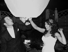Bride & Groom Release a Wish Lantern at a Wedding Reception. I am so going to do this