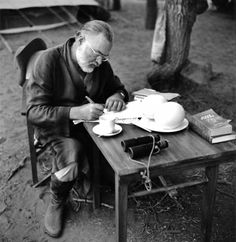 Author Ernest Hemingway poses writes at a portable table while on a big game hunt in September 1952 in Kenya. (Photo by Earl Theisen/Getty Images)