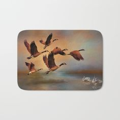 #geese #swans #bath #mat-The perfect bath mats: fuzzy, foamy and finely enhanced with brilliant art. With a soft, quick-dry microfiber surface, memory foam cushion and skid-proof backing, our shower mats are a cut above your typical rug. Keep them clean with a gentle machine wash (no bleach!) and make sure to hang dry.