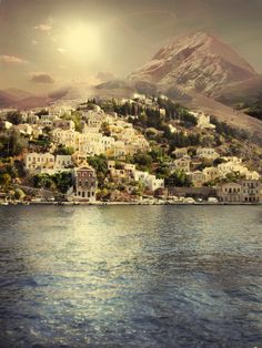 "The harbor town of Symi, Greece is a mountainous Greek island. ""The island got its current name from the nymph Symi, who married the God of the seas Poseidon."