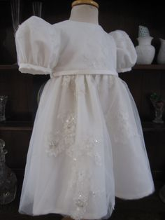 A cute christening dress made from mum's wedding gown. Another from Little Doves, one of the country's most exciting christening gown designers.