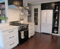 White Kitchen With Black Appliances how to decorate a kitchen with black appliances. shown with white