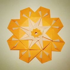 February 21st 2015 Origami mandala I made today. #origami #mandala #modular #paper #folding #orange #flower #diy #craft #52