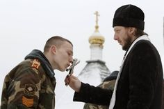 Soldier kissing the cross