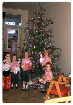 This isn't a photo of us, but this is what Christmas trees and kids and their toys looked like around 1959.