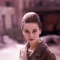 The actress Audrey Hepburn photographed by Pierluigi Praturlon at Piazza Trinità dei Monti in Rome (Italy), in January 1960. Audrey was wearing: • Coat: Leslie Morris for Bergdorf Goodman (of tweed,...