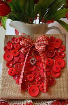 Sew or glue a bunch of little red buttons to form a heart on a piece of canvas. Add a cute bow and heart pendant and it would ultimately look like the cutest Valentine's Day design fit for the love of your life.