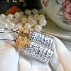 "Downton Abbey in a Jar Earrings    Each tiny vial contains 10 quotes from the wonderful British TV series ""Downton Abbey"" (20 different quotes total!)."
