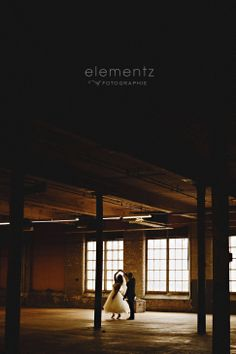 Nathalie and Andrew's Wedding Day » Portraits by #ElementzofFotographie, shot at 270 Sherman, Hamilton, Ontario. Wedding couple's first dance in front of factory windows