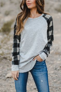 This plaid sleeve top is a must-have for Fall!  So soft and comfy you'll want to wear it every day!  These sell like hot cakes so grab one while you can!