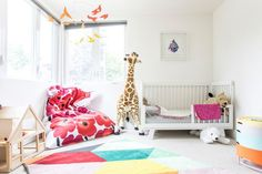 pops of color in a midcentury home nursery