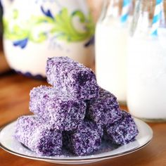 Moist and dense and full of flavor from purple yam, these Ube Bar Bread are coated in shredded coconut to give that special texture. Yummy!