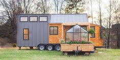 This is the Elsa Tiny Home on Wheels by Olive Nest Tiny Homes in Taylors, SC. It's a 323 sq. ft. tiny house with an adjoining patio extension with a greenhouse! Pretty awesome, isn't it…