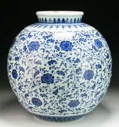 A Massive Chinese Antique Blue & White Porcelain Jar: of Qing Dynasty; flowers and foliage, blue on white. Size: H: 16-1/4""