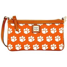 Dooney & Bourke Clemson Leather Wristlet ($88) ❤ liked on Polyvore featuring bags, handbags, clutches, orange, wristlet clutches, genuine leather handbags, orange leather handbag, orange purse and leather clutches
