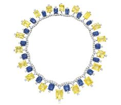 A retro blue and yellow sapphire necklace by Cartier, with diamonds. Circa 1957.