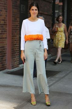 Leandra Medine of the @ManRepeller spotted at #NYFW #SS15 yesterday in barely there neutrals with a pop of orange fringe to break it up.