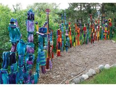 Ceramics play creative functional roles on the farm. Here, more than 5 feet tall, rainbow totems form a 50-foot-long fence. Photo: Russ Vogt