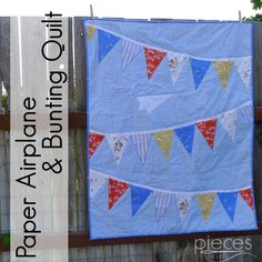Paper airplane and bunting quilt