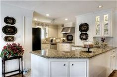 Note: kitchen open to family room, nice counters, and wood floors.