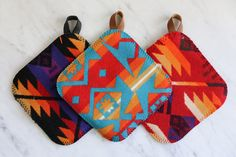 These colorful made-in-America potholders have leather loop handle and are made of western wool.  ($18 each, alderandcoshop.com)   - CountryLiving.com
