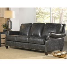 Distressed, Top Grain Leather In An Eye Catching Black Finish Gives  Lazzarou0027s Nathan Grouping A Distinctly Vintage Feeling.