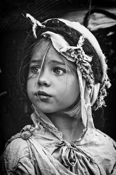 I really like the contrast between black and white because it brings attention to her eyes. Although it is a photograph, it captures her cultural heritage as well through her head dress and clothing which depicts her story.