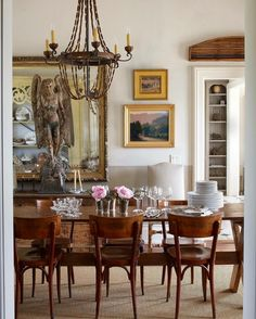 Eclectic Sonoma dining room with massive gilt mirror & 18th c angel…