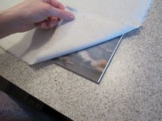 Faux Canvas by layering Mod Podge and then fabric on a photo, push it down, then peel it off!