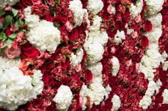 Gorgeous red and white flower wall for a wedding! #flowerwall #weddingflowers #weddinginspiration Designed by: KC Events & Florals in Houston, TX