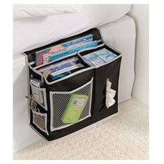 "Showcasing 3 storage compartments with a tissue cutaway and mesh pockets, this bedside caddy is perfect for keeping all of your nighttime essentials in order and within reach.  Product: Bedside caddyConstruction Material: PolyesterColor: Black and grey Features:  Three compartments and mesh pocketsWater resistantFlap fits under mattress Dimensions: 10"" H x 12.5"" W x 5"" D"