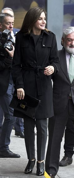 Queen Letizia stepped out in Madrid wearing a black and grey outfit, adding a pair of unus...