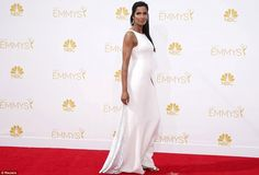 Top dress: Padma Lakshmi sported a high necked white  Ralph Rucci Couture dress, Manolo Blahnik shoes with a  Judith Leiber bag