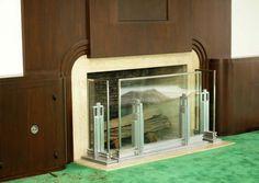 "Fireplace screen made of glass and aluminum, ""skyscraper"" motif ca. 1939."