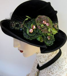 Black velvet hat with ribbon flowers.  When I was little I never went to church or shopping without a hat and gloves.